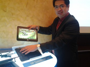 Albert Mateo, Jr., HP Philippines Country General Manager for Printing and Personal Systems group shows how the  HP SlateBook 10 x2 detaches fairly easily from its keyboard via an advanced magnetic hinge design.