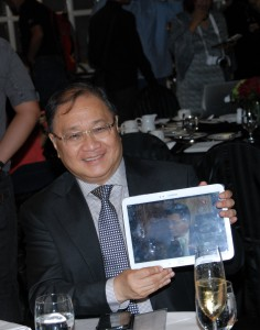 SMART Communications and PLDT Chairman and Cignal founder Manny V. Pangilinan  shows off the latest innovation in television viewing, Cignal TV-to-Go, which allows Cignal subscribers to watch their favorite TV shows continuously even on their mobile devices.