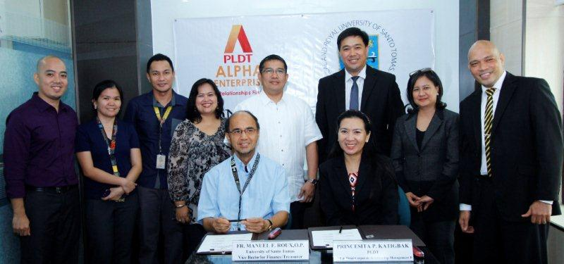 Photo shows (seated) Fr. Manuel F. Roux, O.P., UST Vice Rector for Finance/Treasurer, and Precy Katigbak, PLDT AVP and Corporate Relationship Management Head with (standing from left) Carlo D. Abiog, UST STePs Database Administrator; Cyd Catherine L. Cardozo, UST STePs Management Applications and Admin Systems; Polly T. Blanco, UST STePs Assistant Director for Applications and Software Development; Teresita C. Nabor, UST STePs Admin Information Systems Supervisor; Sebastian Raymond A. Mendoza, UST STePs Director;  Ben Melasa, PLDT Corporate Relationship Business Head; Ma. Lourdes Mendoza, PLDT CapMan Manager; and Al Contreras, PLDT Relationship Manager.