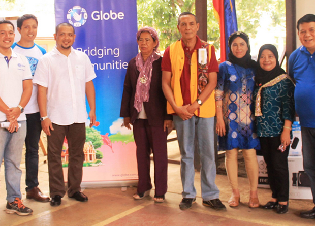 "The Text2Teach launch in Patikul, Sulu was led by its governor, Abdusakur ""Totoh"" A. Tan II, third from left. Together with him are (From L-R):  Fernando Esguerra, CSR Director, Globe Telecom;  Miguel Bermundo, CSR Expert, Globe Telecom; Sabiriya I. Hadjirul Ed.D, Education Program Supervisor, DepEd; Farouk B. Yunus Ed, Education Program Supervisor, DepEd; Sitti Lina A. Asjali, West District Supervisor, DepEd; Mercia Salarda Alli, Chair, Matawkasi Inc.; and Archimedes G. Velasco, Senior Manager, Ayala Foundation, Inc."