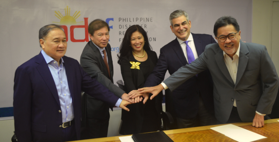 IBM Philippines President and CGM Mariels Almeda Winhoffer (center) with PDRF officials (L-R) Manuel V. Pangilinan, Rene S.  Meily (President of PDRF), Jaime Augusto Zobel de Ayala, Guillermo Luz.