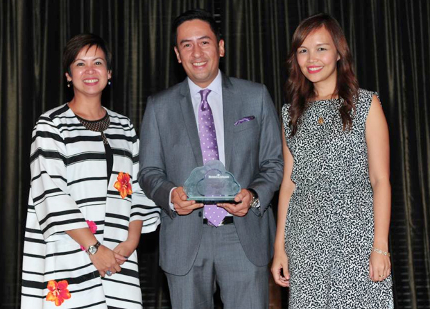 PLDT FVP and Head of PLDT ALPHA Enterprise Jovy Hernandez, center, receives the Microsoft PH Compete Partner of the Year Award from, Microsoft PH Country Manager Karrie Ilagan and Small and Medium Business Lead Prep Palacios