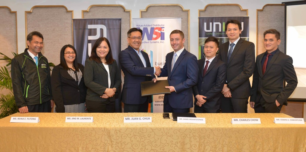WSI President Juan Chua (fourth from left) shakes hands with Unify ASEAN Managing Director Daniel Mountstephen  after signing a partnership distibution deal. Joining them are (from left) WSI Product Manager Jeffrey Garay,  Senior Product Manager Reina Putong and Vice President for Solutions Division Jing Laurente; Unify ASEAN  Distribution Keith Tay and Pre-Sales Director Charles Chow; and Unify Philippines Country Manager Edwin Concepcion.