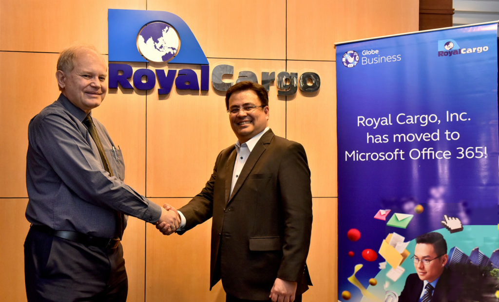 (From R-L) Dion Asencio, Globe Vice President for Enterprise Sales and Michael Raeuber, Royal Cargo Group Chief Executive Officer seal the partnership between Globe and Royal Cargo for the use of Microsoft Office 365.